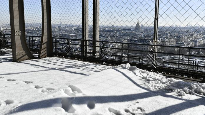 Eiffel tower 1st floor under the snow